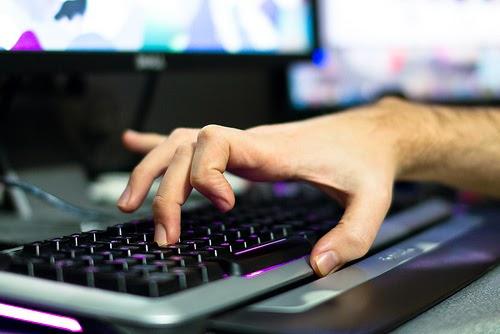 gamer using keyboard